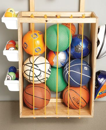 The Family Handyman's solution - a cage for balls; helmet hooks on side of cage