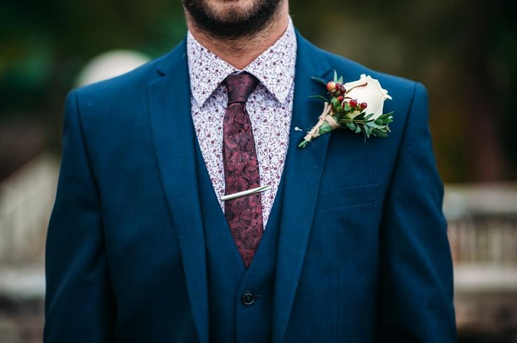 Groom wears a paisley Ted Baker Shirt with maroon skinny tie - Image by Hannah May - Autumnal rustic themed wedding with Navy, Maroon & Gold Colour Scheme. Bride in Lace Wedding Dress & Bridesmaids in beaded Navy dresses. Groom wears a suit from Next & patterned shirt from Ted Baker.