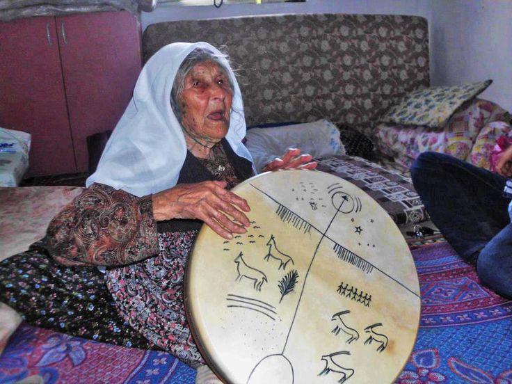 Impassioned Elder Turkish woman, playing Kam (Shaman) drums.
