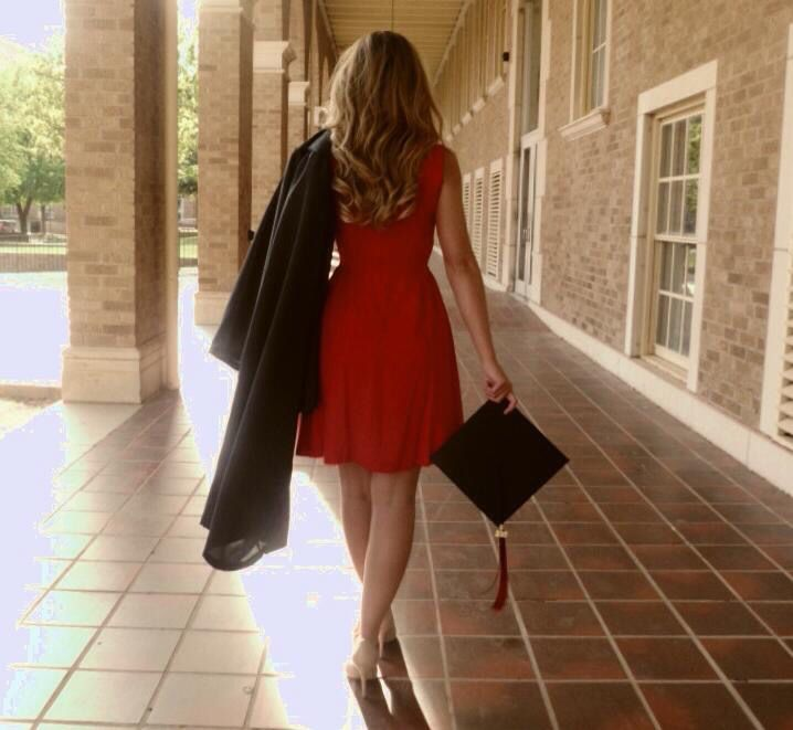 I love the walking away shot with the cap and gown, and that she's walking through the TTU halls with the Tech brick
