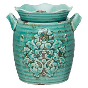 A traditional vessel in trendy blue-green is embossed with ornamental flowers, distressed and antiqued, imparting the look of a cherished vintage object. To purchase, go to www.jenni.scentsy.com.au