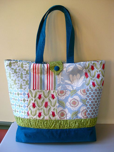 Cute tote that could be made from scrap fabric.  Like that it has a button closure at the top.