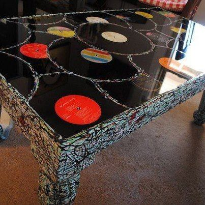 Coffee table made from old albums then covered with for Crafts with old records