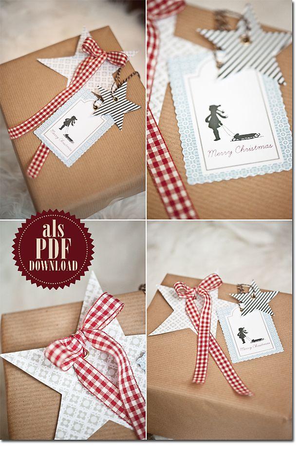 Free printable stars, silhouette girl-with-sled and silhouette Santa Claus gift tags from Les Tissus Colbert: Schlitten und Sterne im Türchen N° 10 – ein Freebie von Karin.