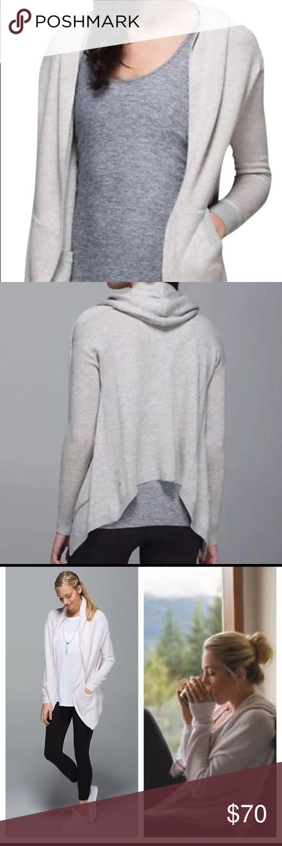 Lululemon Cabin Yogi Wrap Sweater Lululemon Cabin Yogi wrap reversible slouchy sweater/hoodie/wrap. Breathable fabric of tencel blend and is made reversible. Two front pockets on each side. Details include loose fit, thumb holes and is reversible with one side being heathered white and the other neutral nude. lululemon athletica Sweaters Cardigans