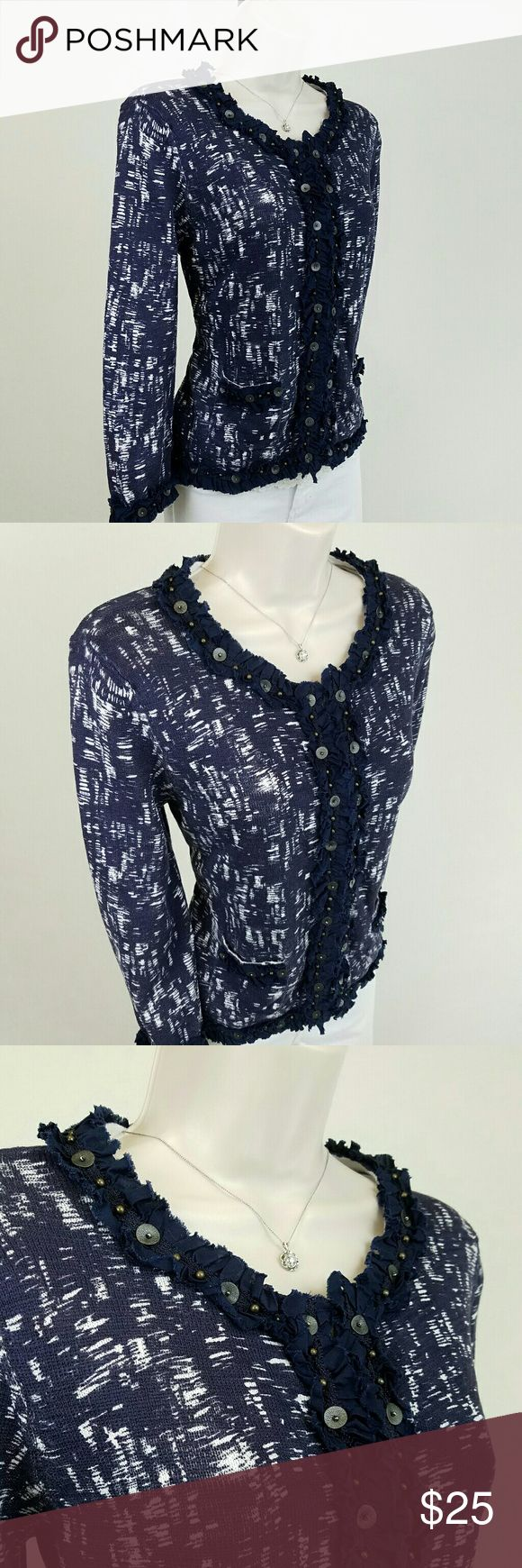 Chico embellished navy cardigan Long-sleeved crew neck cardigan in abstract navy blue and white pattern featuring ruffle trim embellished with tiny brass beads and leather paillettes.  Hook & eye closures and two front pockets. Chico's size 1.  Bust 18.5 / length 21 inches.  100% cotton.  Thanks for visiting my closet!  I add listings every week; come back soon & see what's new! Chico's Sweaters