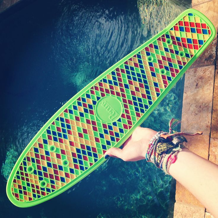 Custom painted Aztec lime green penny board deck by the pool