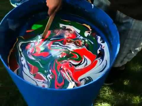 Swirl paint a guitar.  This has got to be on of the coolest projects I've seen.
