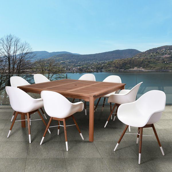 """Elsmere Square 9 Piece Set is the perfect match for every patio and will give your backyard the class and elegance for outdoor dining. This collection combines luxury, beauty, comfort, and an affordable price. This 9 piece dining set seats 8 people and includes a square table and 8 arm chairs. The set is made of solid """"Eucalyptus Grandis"""" wood and it is certified by the FSC (Forest Stewardship Council). The chairs are also made from virgin white resin. The Eucalyptus FSCTM base and ..."""