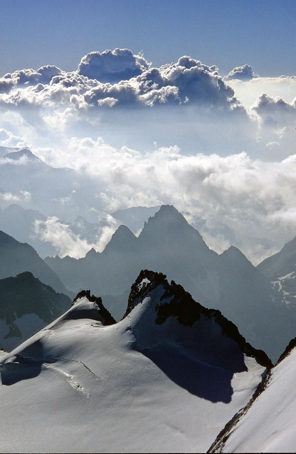 Summer clouds seen from Italy's highest mountain, the Gran Paradis, Italy Valle d'Aosta