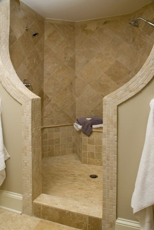 walk-in with no glass...really like this look with no glass to clean. Do cultured marble for shower with tile accent around outside and waterfall inside?
