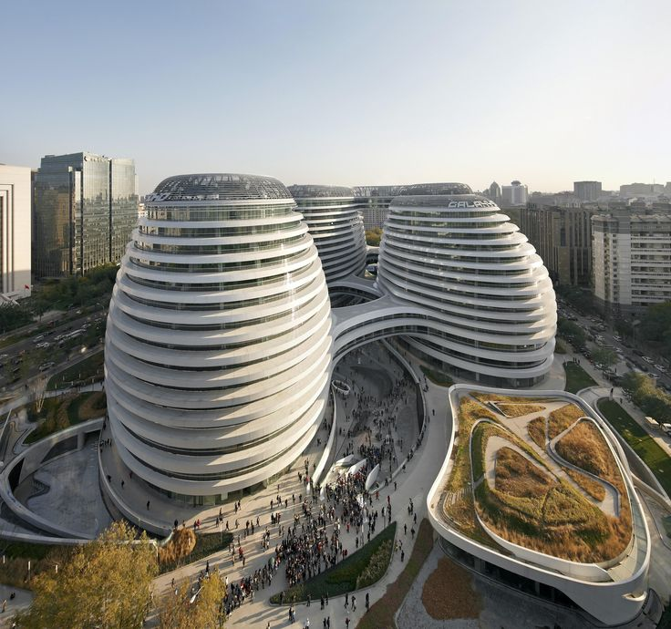Galaxy Soho, a retail, office, and entertainment complex in Beijing, comprises four spherical structures clad in aluminum and stone that are bound together by pedestrian bridges. See more modern architecture designed by Zaha Hadid.