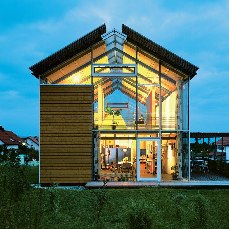 """Architect Reinhold Andris has lived in this house in southwestern Germany since 1998. Fifteen years on, the structure remains emblematic of his modernist perspective. """"It's a very open architecture,"""" he says, noting the near-invisible steel frame and pervasive use of glass. Read more about the modern residence here."""
