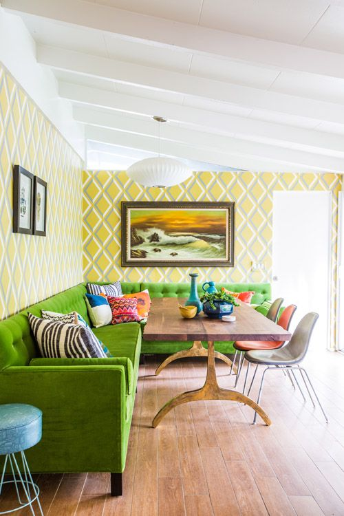 Awesome dining room with green velvet banquette! Yellow Pompeian wallpaper by Cole & Son