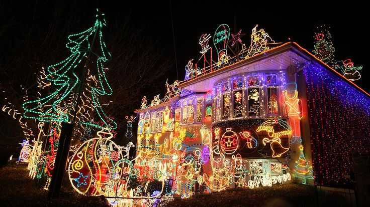 A man stops to admire festive Christmas lights displayed on a detached house in a suburban street December 5, 2009, in Melksham, England. (Getty Images, file)