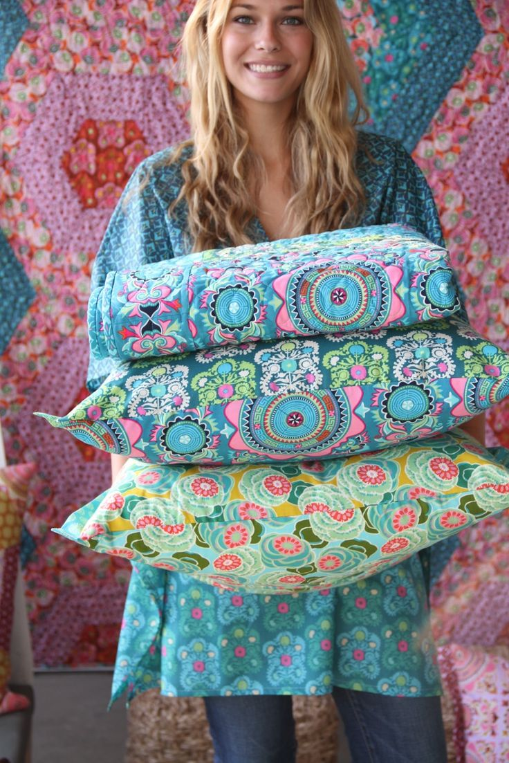 Sewing pillos and more pillows! Love Amy Butler fabric collections. The colors are gorgeous