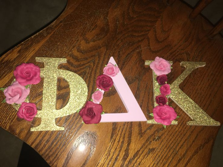 Phi Delta Kappa wooden letters decorated light pink and gold flowers red and pink sorority decoration for initiation floral