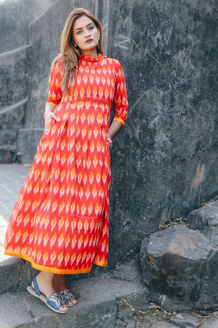 Red High-Neck Ikat Maxi...Mumbai based..Delivery all over India and outside India.For details and bookings pls contact on 7400497020..FB link-https://www.facebook.com/miardesigns/photos/a.1039726666118139.1073741829.1039717622785710/1343669485723854/?type=3&theater