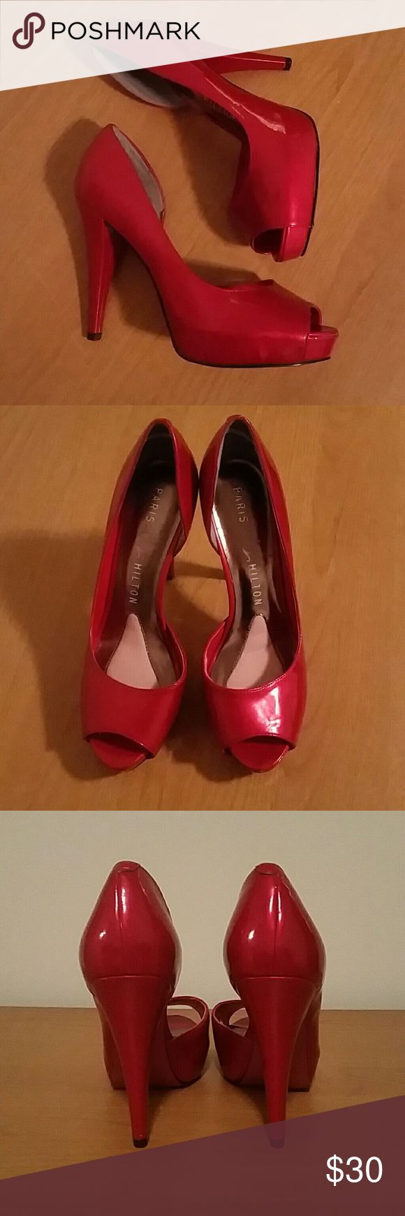Red Paris Hilton pumps Paris Hilton ruby red patent high heels, 4 inch heel height. Open toe with a glossy finish. Look like new, besides scuff marks on the bottom of the shoe. Size 6 1/2. Paris Hilton Shoes Heels