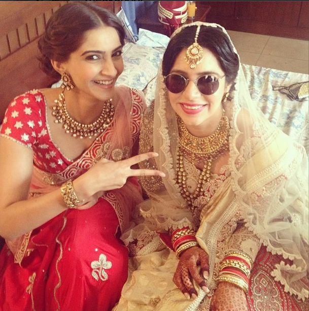 Karishma Boolani in Anamika Khanna bridal featuring a lace blouse and dupatta with Sonam Kapoor - Indian wedding fashion - Indian designer - modern Indian wedding - Indian bridal fashion #thecrimsonbride