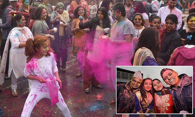 A riot of colour as hundreds of Hindus celebrate the festival of Holi