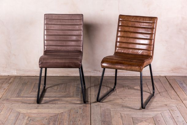 clay and tan leather dining chairs