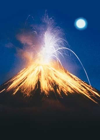 Arenal Volcano puts on a fiery display under a full moon