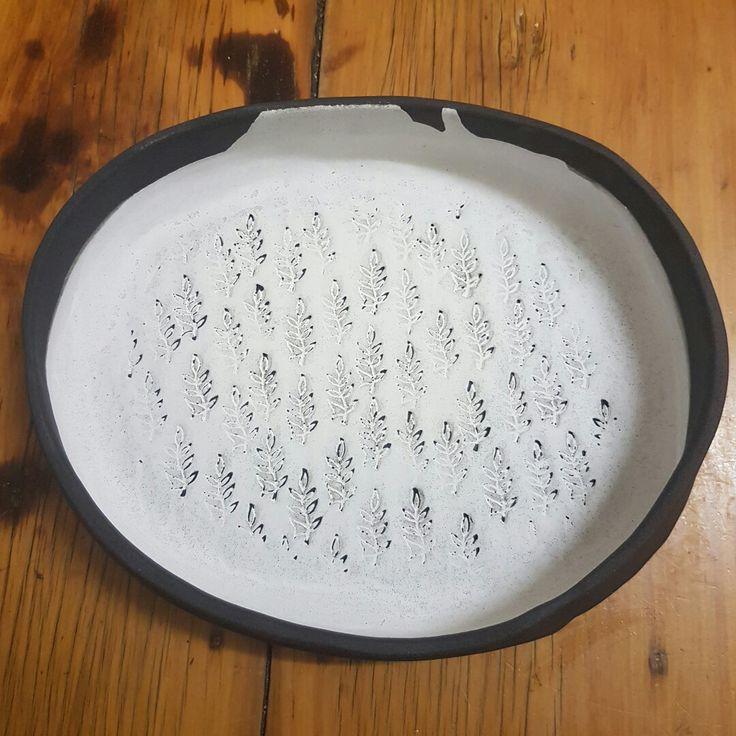 Black clay with white underglaze