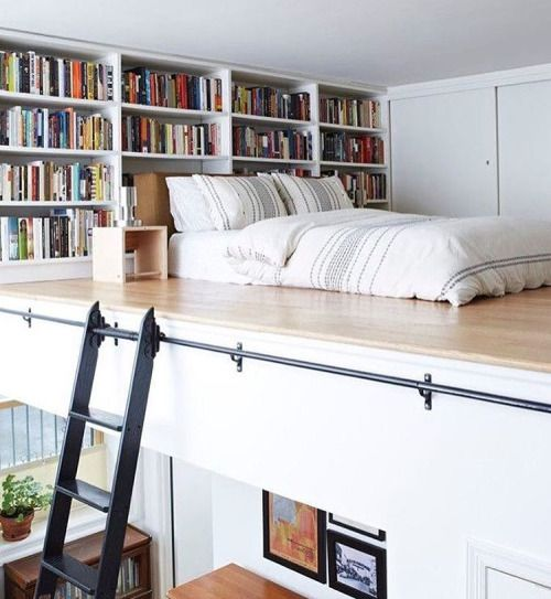 A sleeping loft with books.  I want to incorporate this into our cabin design.