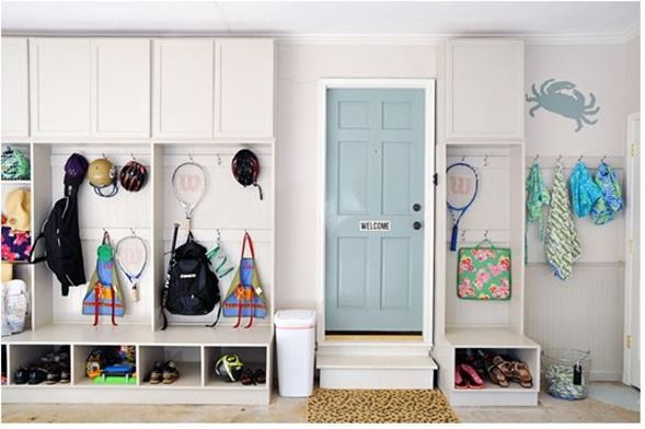 organized pretty garage from i heart organizing. that door area looks like a pretty awesome mud room.