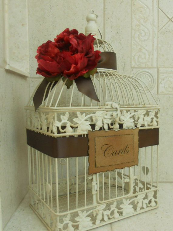 wedding birdcage card holder go to a thift store like goodwill or salvation army spray paint cage to match theme wrap with ribbon and label