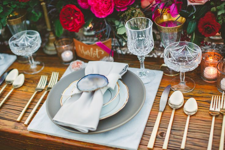 White marble charger plates, modern gold flatware, agate slices, leather place cards, vintage crystal glassware and wood farm table for wedding reception | Modern & Earthy Biddle Ranch Styled Shoot | Lovelyfest Event Design