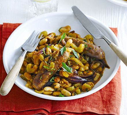 Venison sausages with piquant beans. Spruce up your staple sausage and beans with this low-fat, filling recipe - try venison sausages for even more flavour
