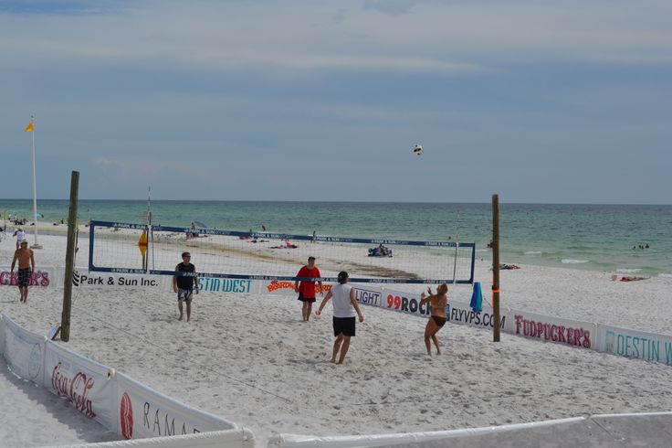 Quick game of volleyball down by the beach!