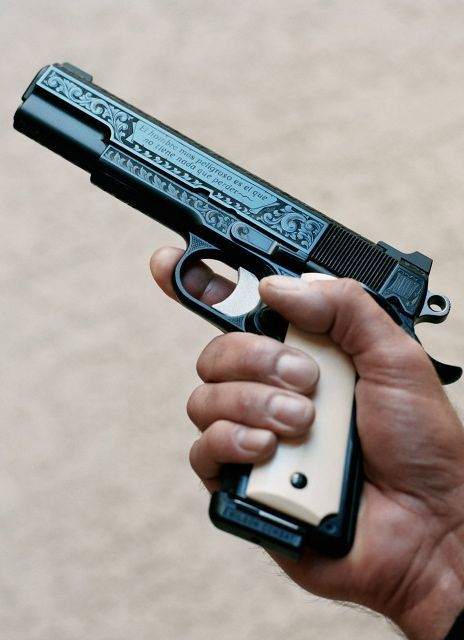 """Colt 1911 .45 ACP, extensively engraved. The saying on the slide in Spanish translates to:""""The most dangerous man is he who has nothing to lose."""""""