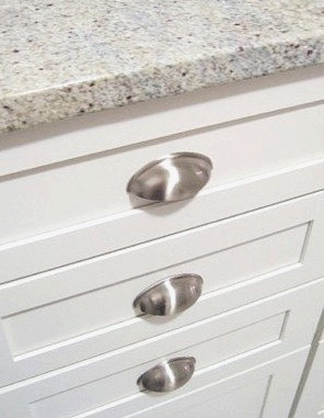 Polished Nickle Cup Pulls On White Shaker Cabinets