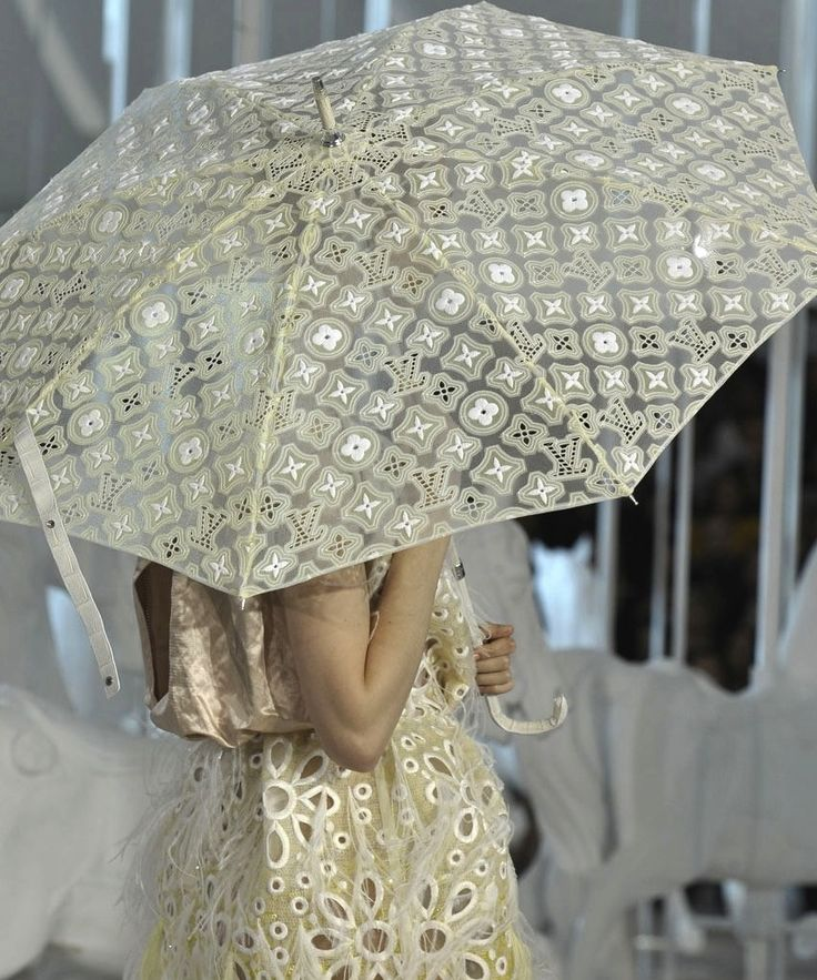 """lv umbrella-  Actually rather nice and parasol like.  However my only problem is that LV is such a brand for the nuveau rich that screams """"look at me!!! I paid 100 dollars for this umbrella"""" Accessories are not so up-market so as to be unaffordable either. But that said this is nice for them."""