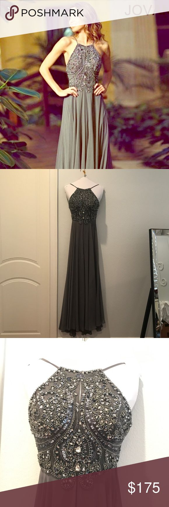 """Jovani Charcoal / Grey wedding or prom formal gown Beautiful gown. I wore it to a wedding and had so many compliments!! This dress is perfect for any formal event like prom. It gives you a beautiful shape and comes with built in cups. Hemmed to fit 5""""7. There a couple of beads missing that are barely noticeable and a few water stains in the chiffon that are difficult to picture (reflected in price). Dry cleaned immediately. Jovani Dresses Prom"""