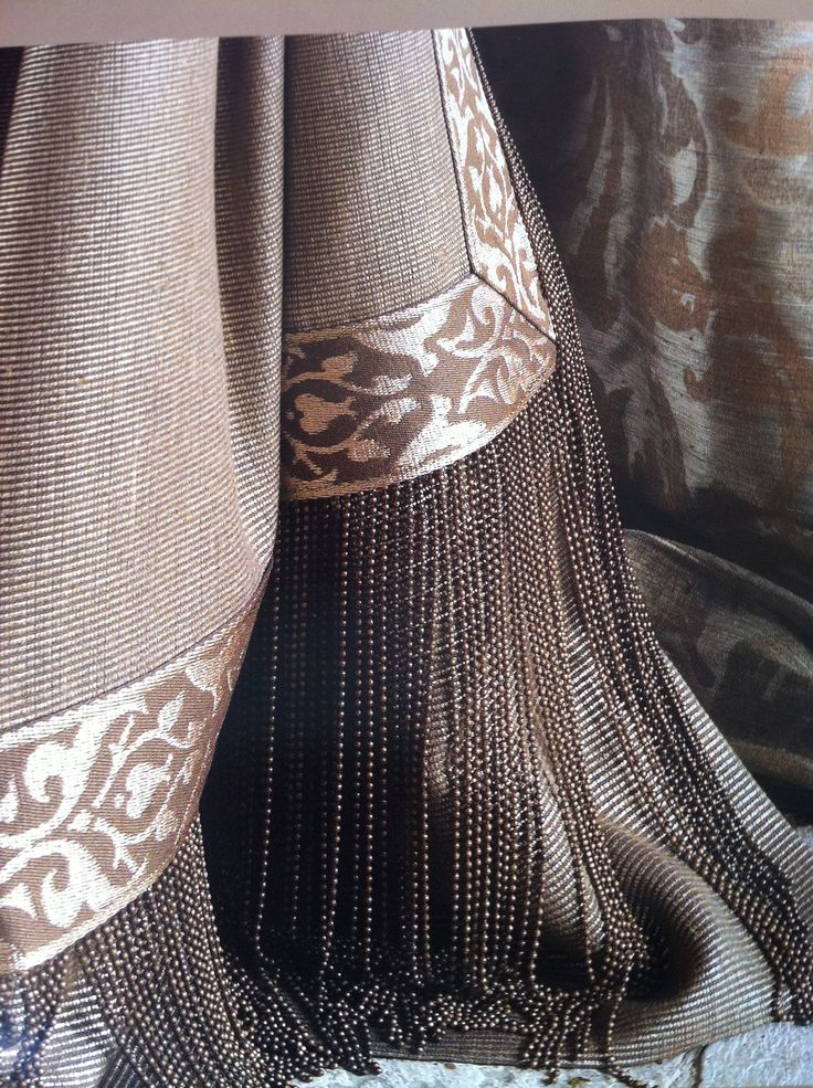 Puddled curtains & details in lovely palette. Amazing micro-beaded fringe!
