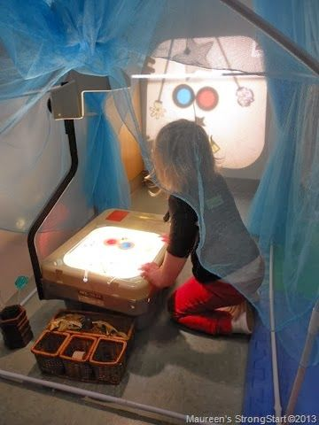 Overhead projector under a cozy nook- exploration from Strong Start - Maureen Wagner