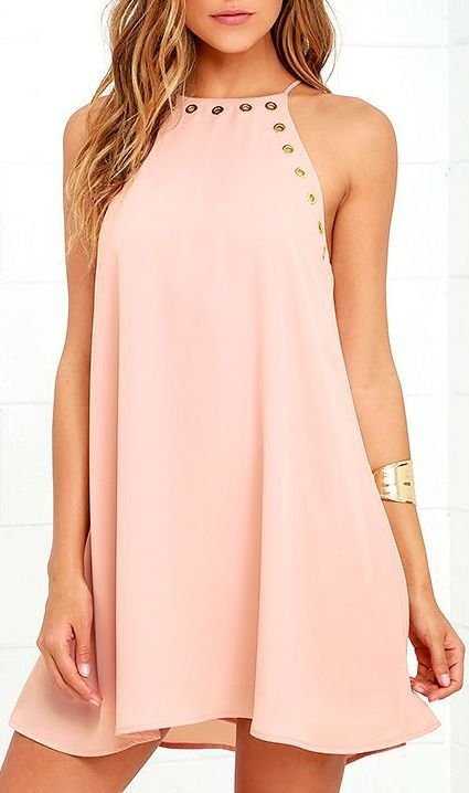 The grommet trend is here to stay thanks to the Amara Blush Swing Dress! This sleeveless, woven dress has a strappy halter neckline, and wide arm openings trimmed in gold grommets. Classic swing silhouette ends at a flirty hem. #lovelulus