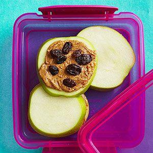 Apple Raisin Sandwich recipe with peanut butter and raisins on apple slices.