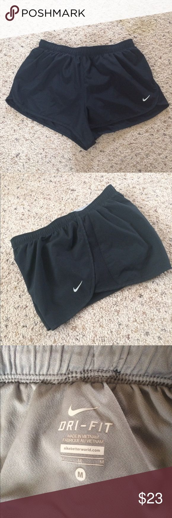 """Nike 2 Road Race Shorts Black Running M Elastic waistband with internal drawcord for a snug, comfortable fit Built-in briefs for support and comfort Vented side panels for enhanced range of motion and style Reflective details for enhanced visibility in low-light conditions  Size M: 2"""" inseam based on size medium Fabric: Body: Dri-FIT 100% polyester. Lining: Dri-FIT 100%  polyester. Machine wash Color: Black Nike style-color # 321647 Excellent condition. No rips stains or tears. Comes from a…"""
