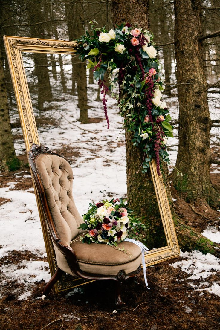 Large Ornate Frame with Vintage Chair adorned with floral decor | Winter Bridal Inspiration | Woodland | Stationery By Emma Jo | Flowers By Wild Orchid | Images by Jo Bradbury Wedding Photography | http://www.rockmywedding.co.uk/the-winters-tale/