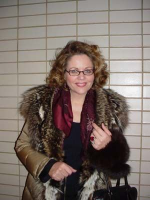 Renee Fleming, offstage and with glasses.