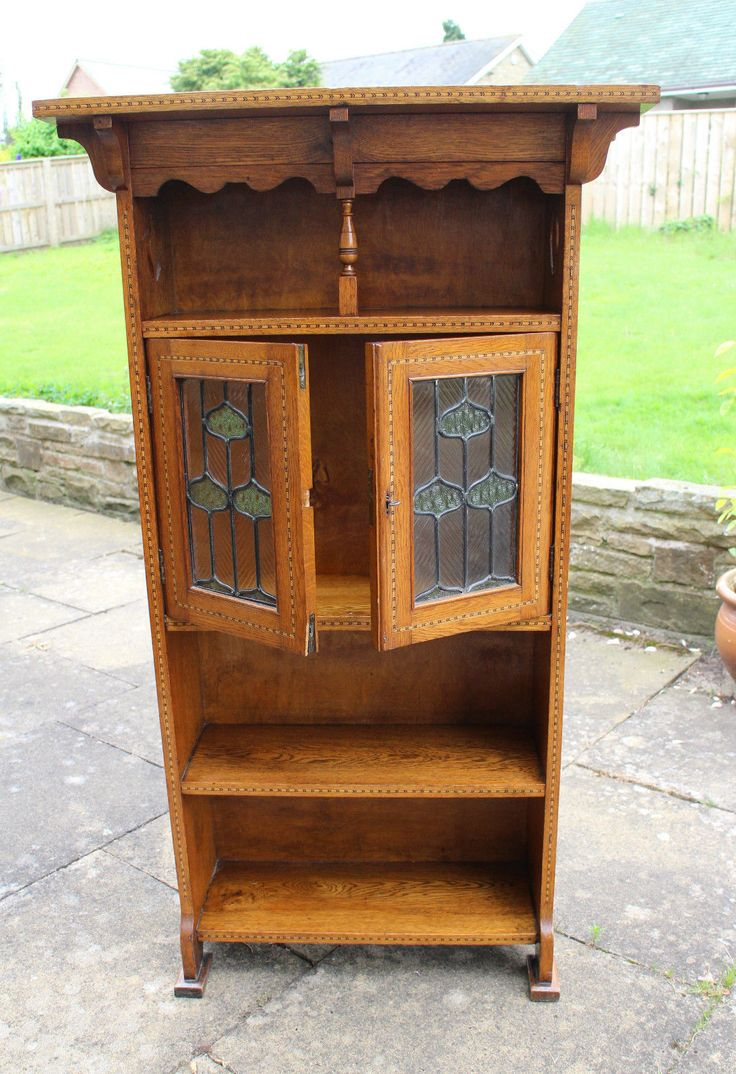 Golden Oak Art Nouveau Glazed Cabinet/Bookcase with Marquetry inlay. Size is 54 inches in height x 30 inches wide x 11 inches deep. Beautiful leaded glazed doors with key.