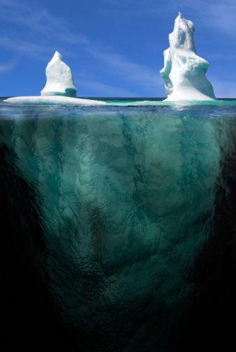 Iceberg above and below. Labrador water line, Canada.