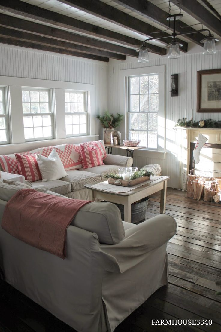 Neutral living room with colorful quilts and pillows