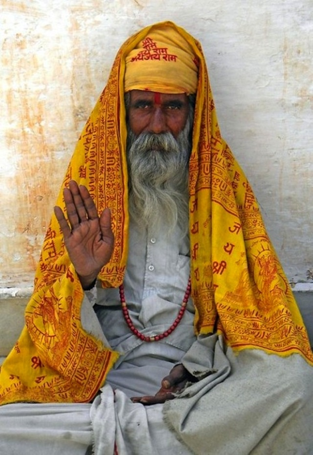 I love the bright colour set against the grey. he look peaceful and you eye is drawn into the mans face.: People Faces, India Faces, Beauty, Beautiful People, Holy Man, Photo, Sadhu, Culture