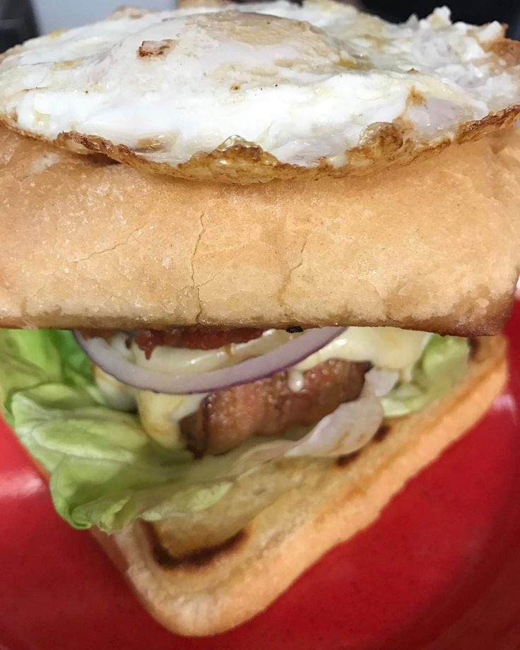 Breakfast fatty: pork and angus burger wrapped in bacon lettuce red onion tomato jam provolone your way egg.  Holly's Gourmets Market  #Knoxville #Catering #Wedding #Lunch #Breakfast #Restaurant